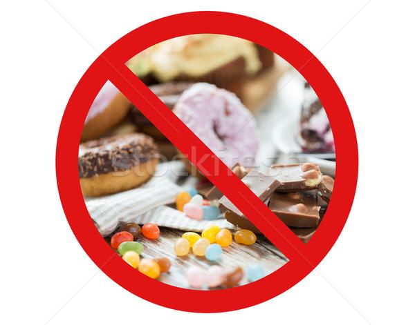 close up of chocolate and sweets behind no symbol Stock photo © dolgachov