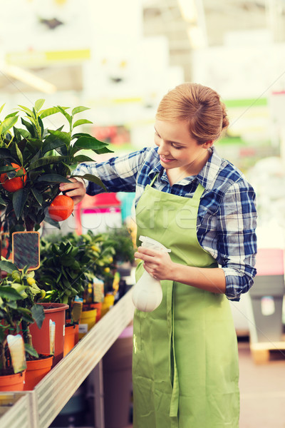 happy woman touching mandarin tree in greenhouse Stock photo © dolgachov