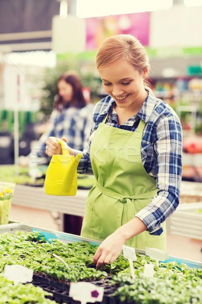 幸せ 女性 じょうろ 温室 人 ガーデニング ストックフォト © dolgachov