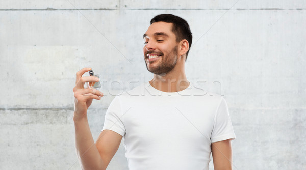 Sorridente homem masculino perfume cinza perfumaria Foto stock © dolgachov