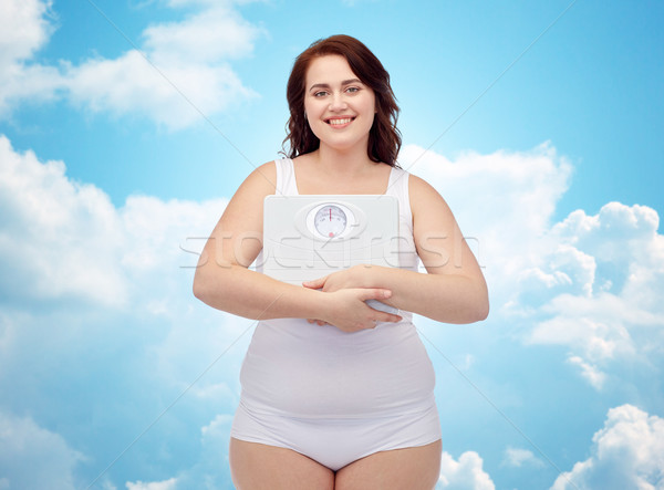 happy young plus size woman holding scales Stock photo © dolgachov