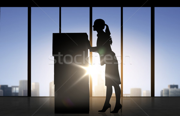 silhouette of businesswoman moving boxes at office Stock photo © dolgachov