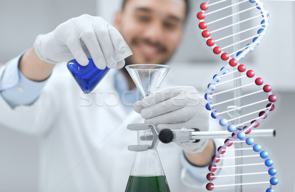 close up of scientist with test tubes and funnel Stock photo © dolgachov