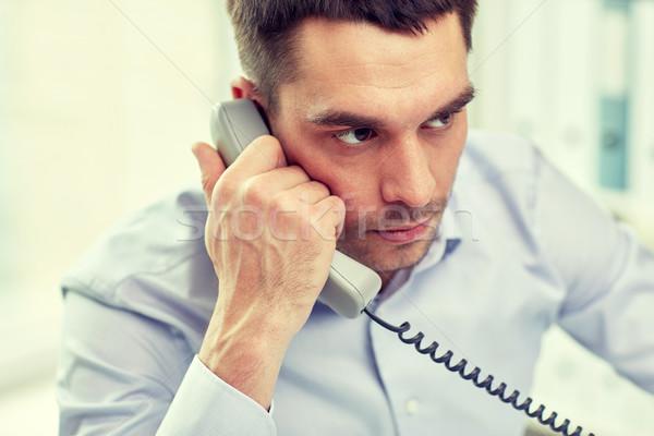 Cara empresário chamada telefone escritório pessoas de negócios Foto stock © dolgachov