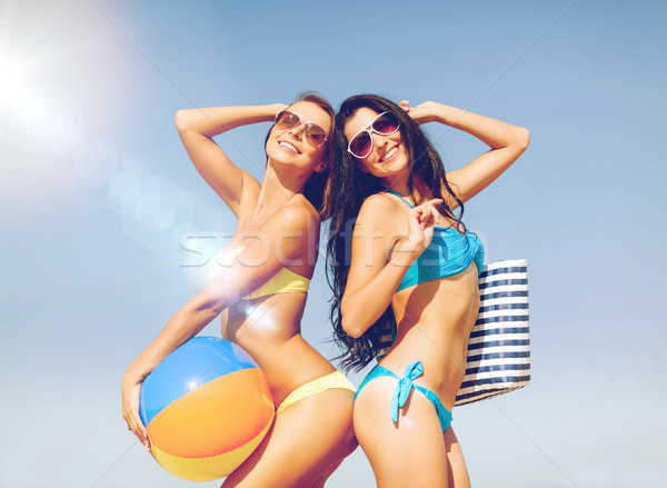 Stock photo: girls with ball on the beach
