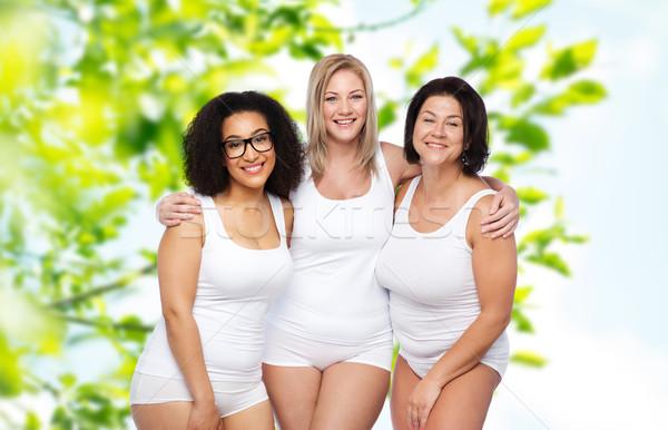 Grup mutlu artı boyutu kadın beyaz iç çamaşırı Stok fotoğraf © dolgachov