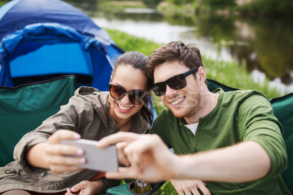 couple of travelers taking selfie by smartphone Stock photo © dolgachov