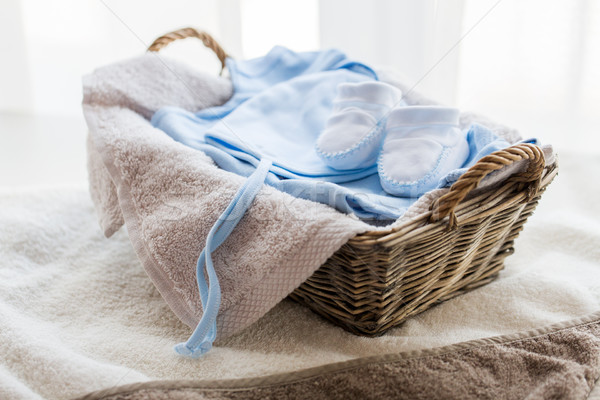 close up of baby clothes for newborn boy in basket Stock photo © dolgachov