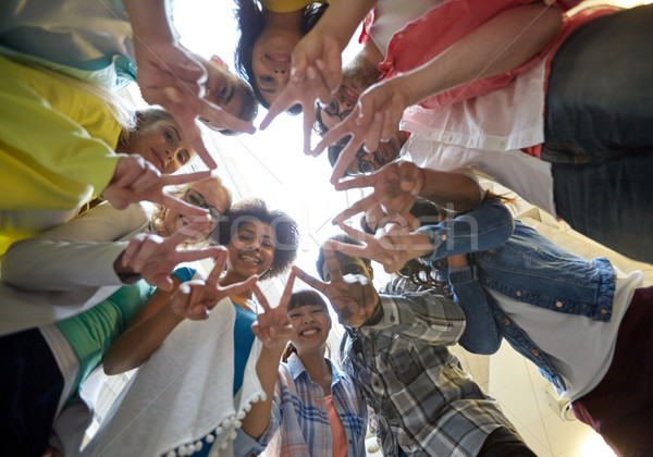 international students showing peace or v sign Stock photo © dolgachov