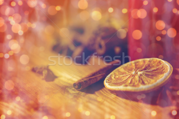 cinnamon, anise and dried orange on wooden board Stock photo © dolgachov