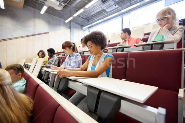 group of students with notebooks at lecture hall Stock photo © dolgachov