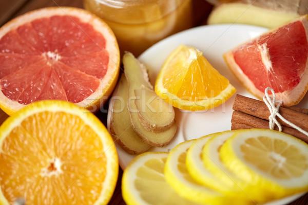Méz citrus gyümölcsök gyömbér fahéj hagyományos Stock fotó © dolgachov
