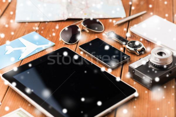 close up of smartphone and travel stuff Stock photo © dolgachov