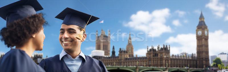 happy students or bachelors in mortar boards Stock photo © dolgachov