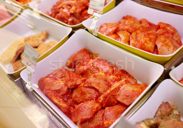 marinated meat in bowls at grocery stall Stock photo © dolgachov
