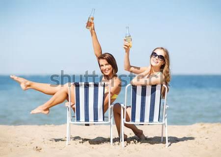 счастливым напитки солнечные ванны пляж лет Сток-фото © dolgachov