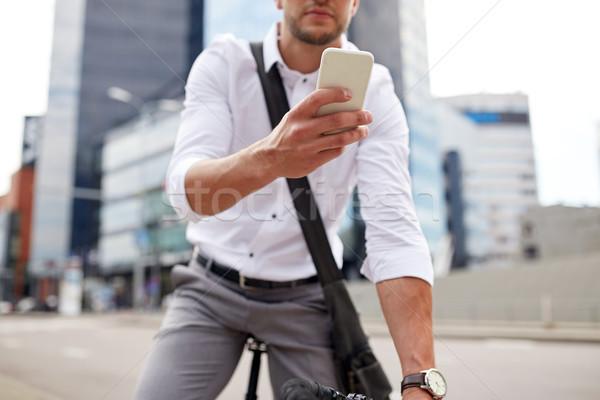Сток-фото: человека · смартфон · зафиксировано · Gear · велосипедов · улице