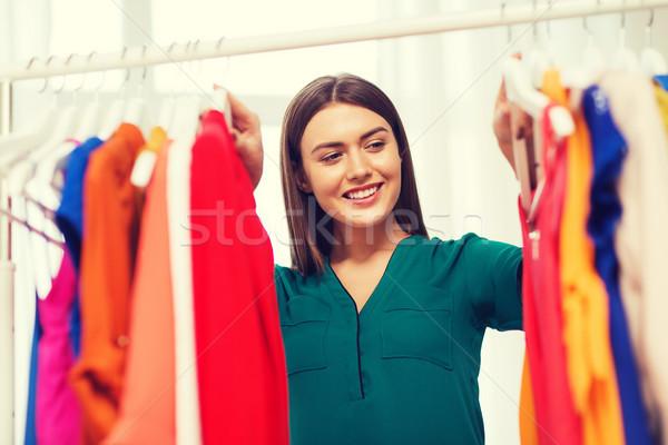 Heureux femme vêtements maison armoire Photo stock © dolgachov