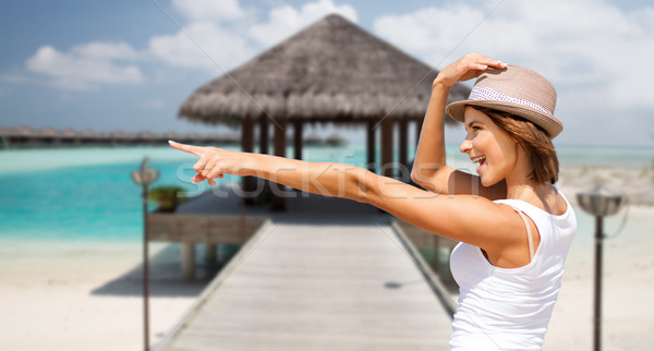 幸せ 若い女性 帽子 夏 ビーチ 休日 ストックフォト © dolgachov