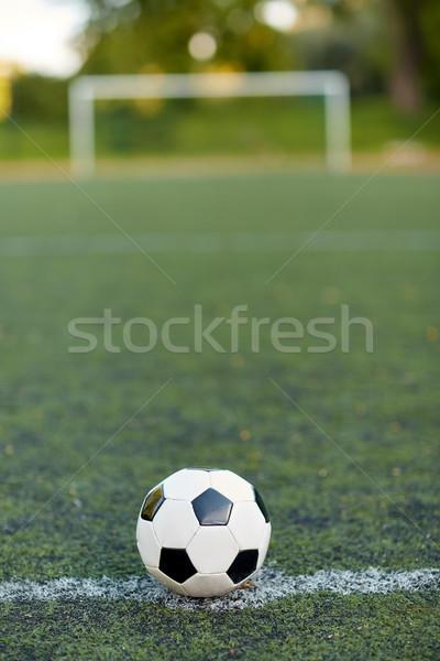 soccer ball on football field marking line Stock photo © dolgachov