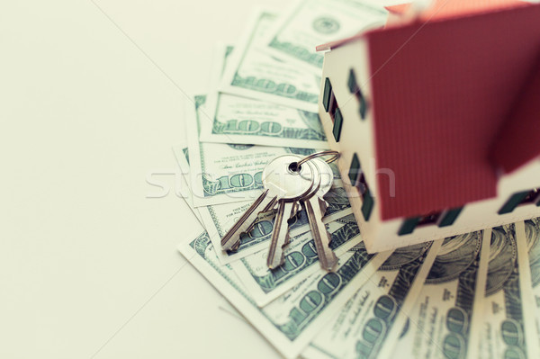 close up of home model, money and house keys Stock photo © dolgachov