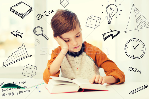 student boy reading book or textbook at home Stock photo © dolgachov