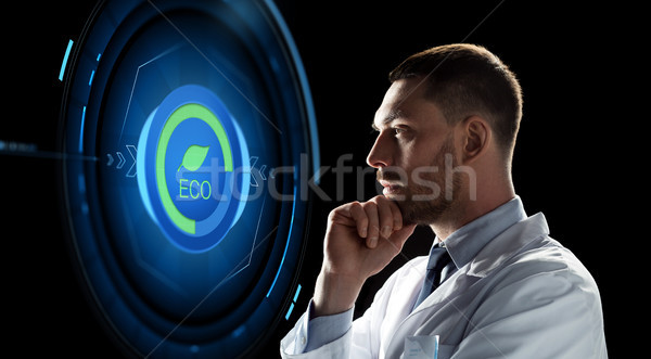 scientist looking at virtual projection Stock photo © dolgachov