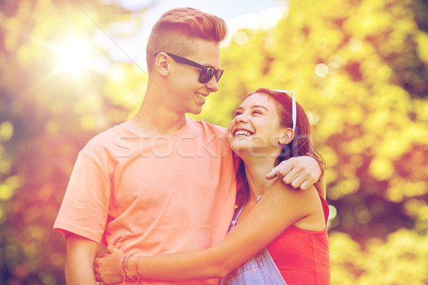 happy teenage couple looking at each other in park Stock photo © dolgachov