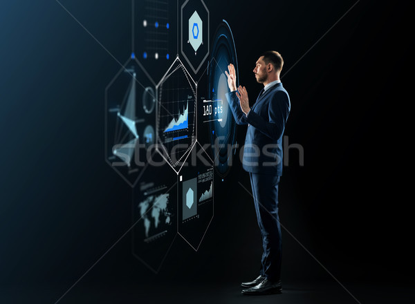 businessman working with virtual projection Stock photo © dolgachov