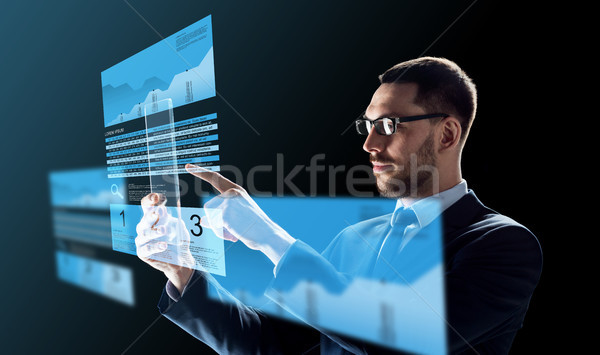 businessman with tablet pc and exchange charts Stock photo © dolgachov