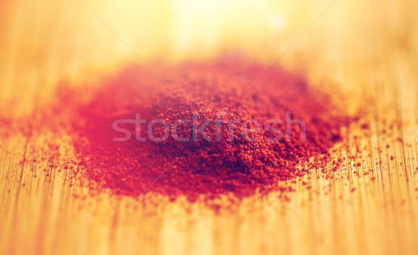 cayenne pepper or paprika powder on wood Stock photo © dolgachov