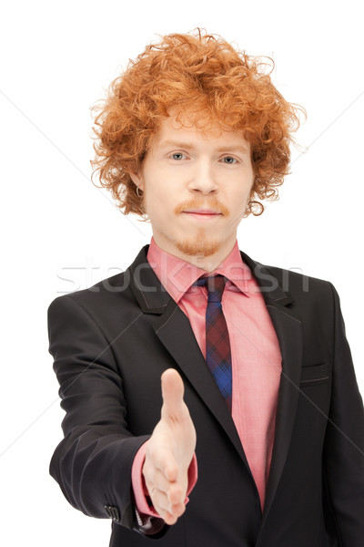 man with an open hand ready for handshake Stock photo © dolgachov