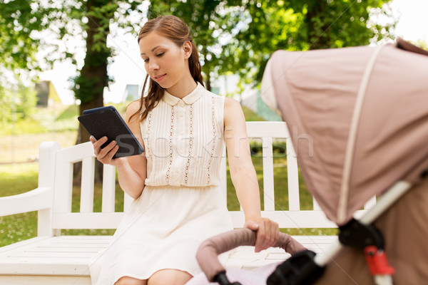 happy mother with tablet pc and stroller at park Stock photo © dolgachov