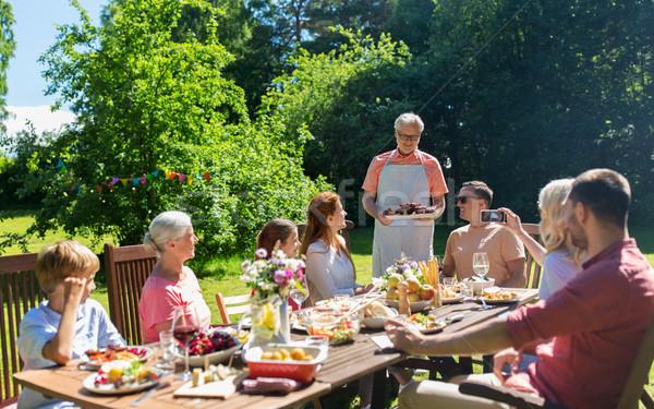 ストックフォト: 幸せな家族 · ディナー · 夏 · ガーデンパーティー · レジャー · 休日