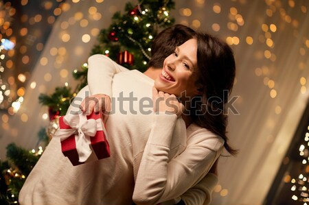 happy woman with flowers and greeting card at home Stock photo © dolgachov