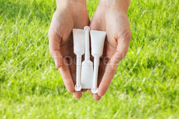 Kéz tart csövek mikro gyógyszer egészségügy Stock fotó © dolgachov