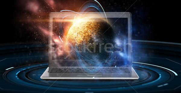 Laptop virtual planeta espaço holograma astronomia Foto stock © dolgachov