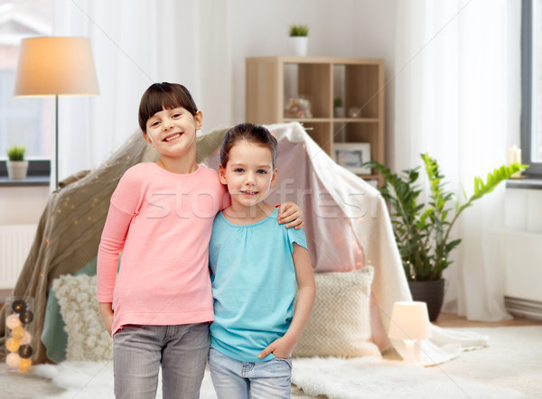 happy smiling little girls hugging at home Stock photo © dolgachov