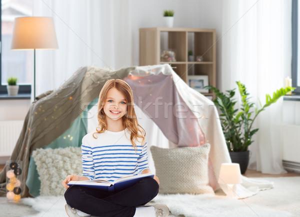 happy smiling girl reading book at home Stock photo © dolgachov