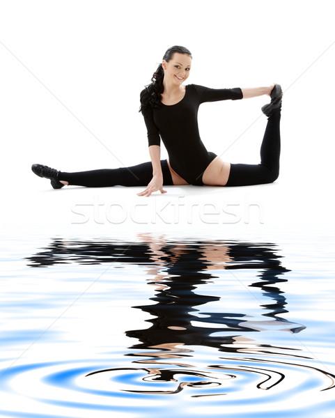 fitness instructor in black leotard on white sand #2 Stock photo © dolgachov