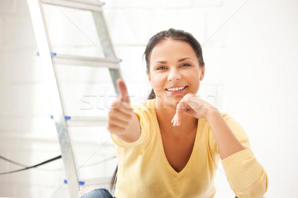 lovely housewife making repairing works Stock photo © dolgachov