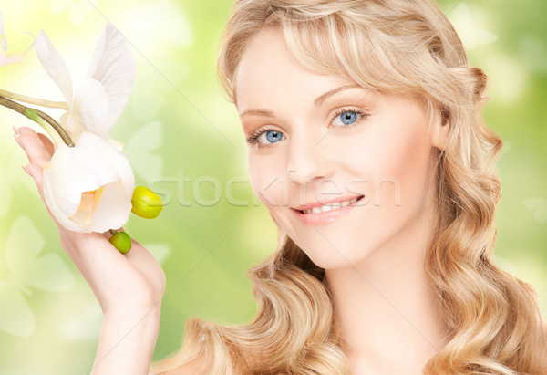 Stock photo: beautiful woman with orchid flower and butterflies