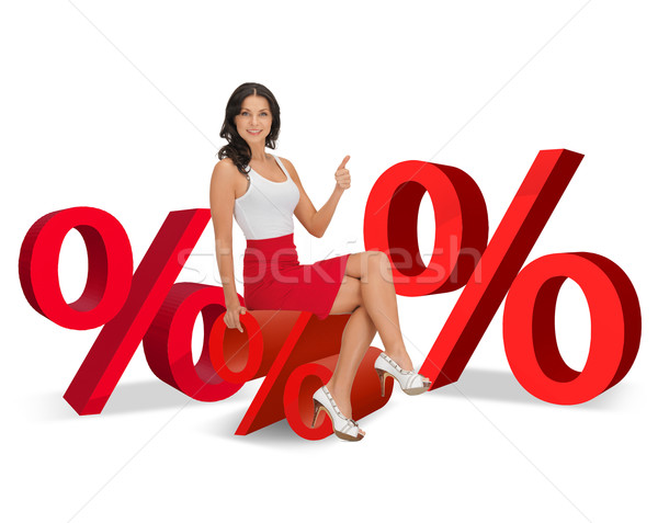 Stock photo: woman sitting on big red percent sign
