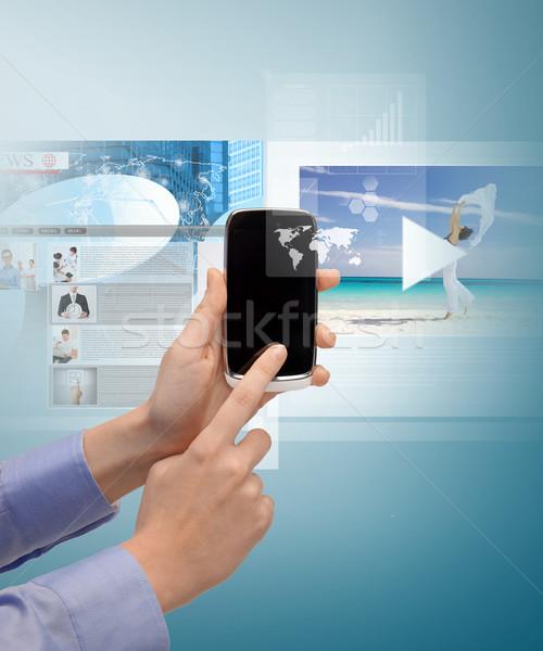 woman with smartphone and virtual screens Stock photo © dolgachov