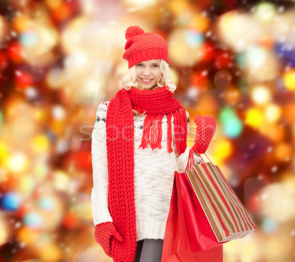 Stock photo: teenage girl in winter clothes with shopping bags