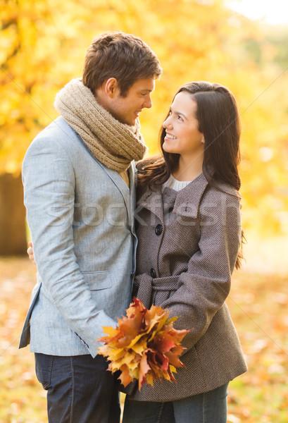 romantic couple kissing in the autumn park Stock photo © dolgachov