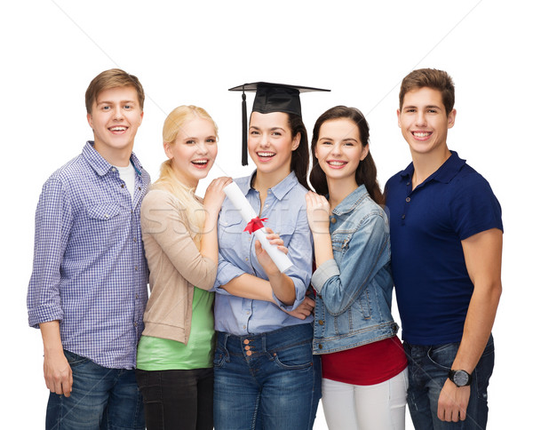 group of standing smiling students with diploma Stock photo © dolgachov