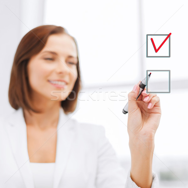 businesswoman drawing chech into chechbox Stock photo © dolgachov