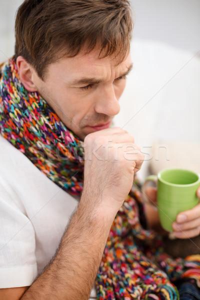ill man with flu at home Stock photo © dolgachov
