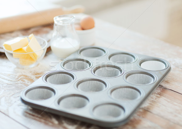 close up of empty muffins molds Stock photo © dolgachov